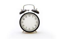 Despertador en estilo retro en el fondo blanco Imagen de archivo