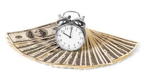 Despertador en los billetes de dólar aislados imagen de archivo libre de regalías