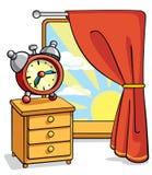 Despertador no nightstand Foto de Stock