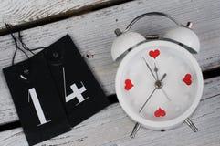 Despertador o 14 de fevereiro - conceito do amor Fotografia de Stock Royalty Free
