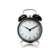 Despertador preto isolado com trajeto cliping Imagens de Stock Royalty Free