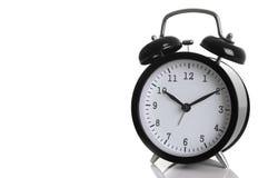 Despertador preto isolado no branco Imagem de Stock Royalty Free