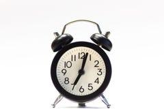 Despertador preto isolado no branco fotos de stock royalty free