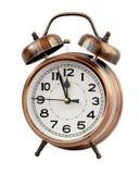 Despertador retro a las doce, aislante Imágenes de archivo libres de regalías