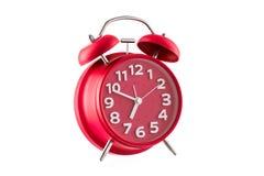 Despertador rojo, aislado en blanco imagen de archivo