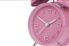Despertador rosado con las manos en 10 y 2 Fotos de archivo libres de regalías