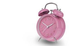 Despertador rosado con las manos en 10 y 2 Imagen de archivo libre de regalías