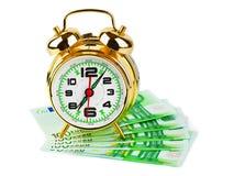Despertador y dinero Imagen de archivo libre de regalías
