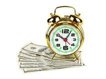 Despertador y dinero Fotos de archivo