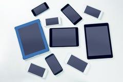 Despesas gerais dos smartphones e das tabuletas Fotografia de Stock Royalty Free