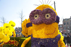 Despicable character with flowers Royalty Free Stock Images
