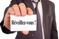Despierte la escritura en francés en una tarjeta fotografía de archivo libre de regalías