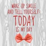 Despierte, sonríe y se dice: El HOY es mi ejemplo del VECTOR del día con el arco realista Foto de archivo