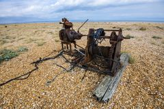Possible barrage balloon winch left over from World War II at Dungeness, Kent, England. Despite the modern rope draped on this old winch, the drum contains wire stock photography