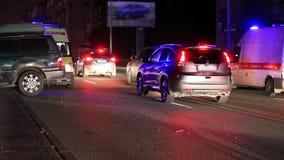 Desplome y ambulancia en la noche Foto de archivo