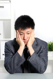 Despondent Asian businessman Royalty Free Stock Photo
