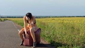 Despondent female hitchhiker Royalty Free Stock Photos