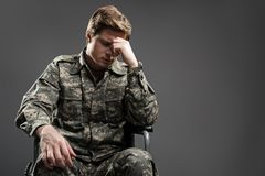 Cheerless disabled young male frowning royalty free stock images