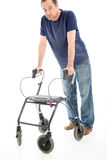 Despondent man leaning on medical walker Royalty Free Stock Image