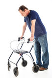 Despondent man on medical walker Royalty Free Stock Photo