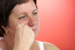 Despondent mature woman Royalty Free Stock Photos
