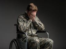 Despondent military man feeling helpless royalty free stock photo