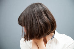 Despondent young woman hiding her face Royalty Free Stock Photo