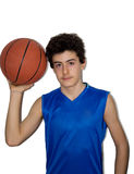 Desportista adolescente que joga o basquetebol Imagem de Stock