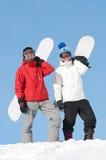 Desportista feliz com snowboards Imagens de Stock Royalty Free