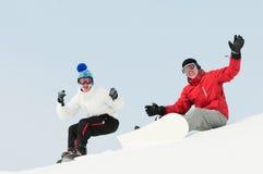 Desportista feliz com snowboards Fotografia de Stock