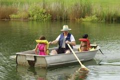 Desporto de barco com Grandpa foto de stock royalty free