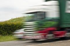 dess lorry som långt rusar Royaltyfri Foto