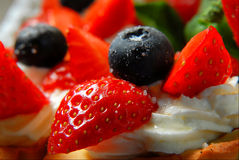 Desser. T with fresh berries with a cream, decorated with a strawberry and a bilberry stock image