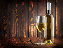 Desser white wine on the table. Desser white wine on a wooden background stock photo