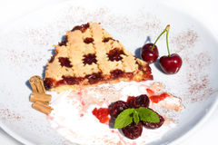 Dessert. Food & Drinks - Slice of tart with sour cherry jam Stock Photo