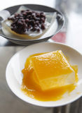 Dessert. Jelly with mango sauce on the dish. Another one is out of focus. It with milk and red bean on the dish Stock Photo