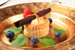 Dessert. Cream filled puff pastry shell garnished with fresh fruit Stock Images