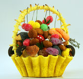 Dessert. Cake in a basket of berries and mushrooms Royalty Free Stock Image