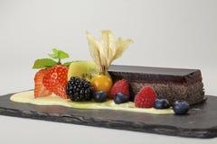 Dessert. Chocolate dessert with raspberries, strawberries, blackberries and blueberries Stock Image