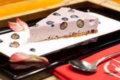 Dessert. Slice of cheesecake with fresh grape Royalty Free Stock Images