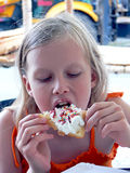 Dessert. Young blond girl eating waffle with cream and syrup Royalty Free Stock Photos