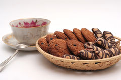 Dessert. Cup and a plate of biscuits on a white background Stock Photography