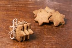 Dessert as gift. New Year. Gingerbread Cookie. Brown background. Homemade Royalty Free Stock Photo