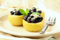 Dessert of baked apple with raisins Stock Photography