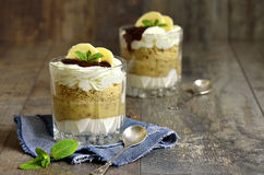Dessert from banana,biscuits and whipped cream. royalty free stock photos