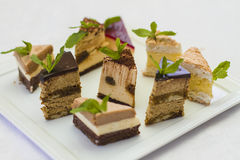 Dessert banquet. 9 cakes on one plate Royalty Free Stock Images
