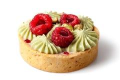 Dessert basket with pistachios cream. Uncut dessert basket with pistachios cream and fresh raspberries royalty free stock images