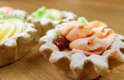 Dessert baskets cream sprinkled Stock Image