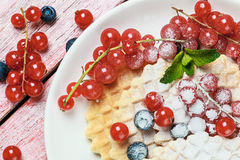 Dessert with Belgian waffles and berries Stock Photography