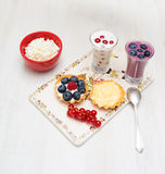 Dessert  berry currant bilberry raspberry milk on a wooden board Stock Images